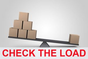 check load stability before moving heavy machinery